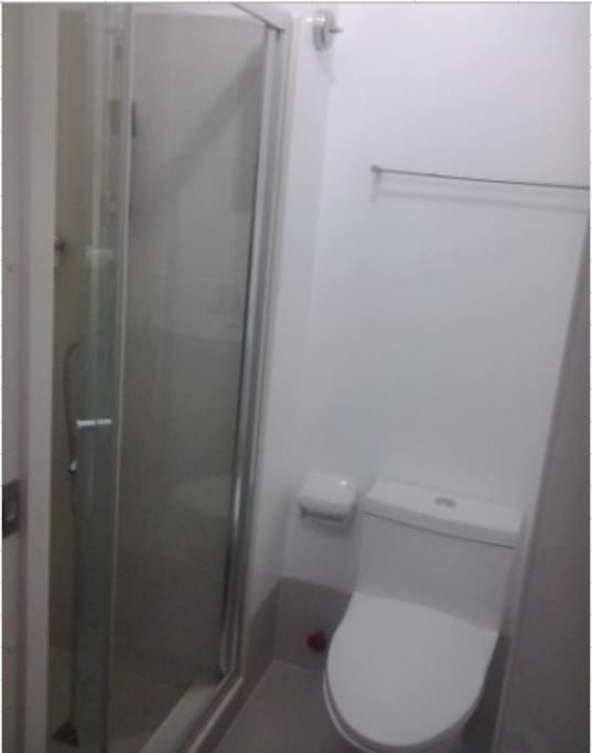 With shower heater and shower enclosure.