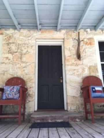 Our charming rock cottage has a huge front porch where you can relax with a pitcher of tea, a can of beer or a glass of wine.