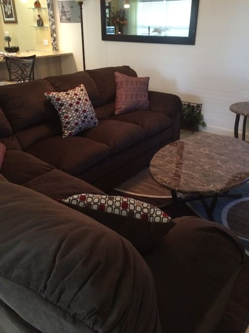 Brand new comfy l-shaped couch and table