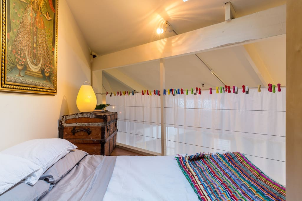 the loft with curtain pulled for privacy