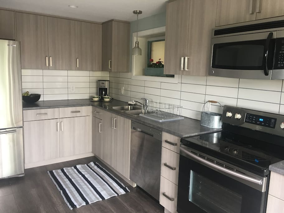 Brand new kitchen built in 2016 with new stainless appliances.