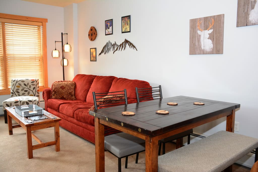 There's plenty of seating in the open living/dining area! Sofa pulls out to a queen sleeper. Welcome to your Copper Mountain condo!