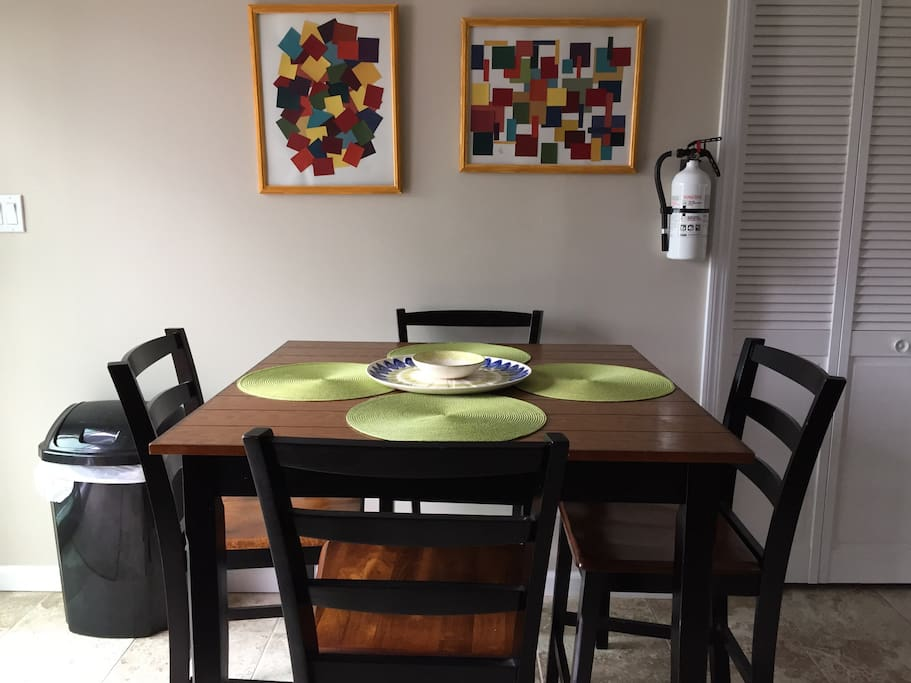 Tall dining table with additional seating on the counter bar stools
