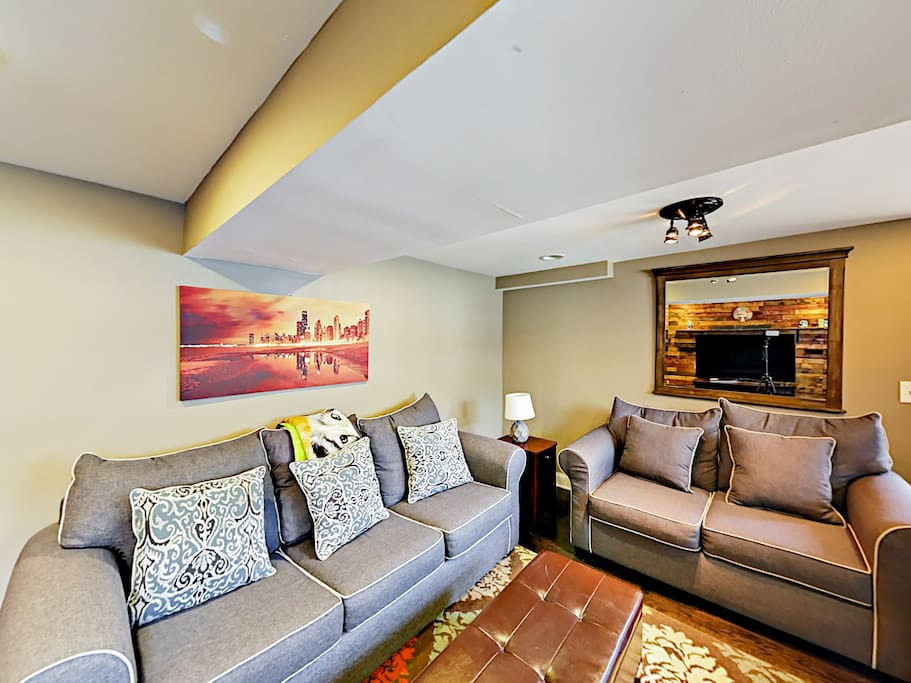 Sprawl out on 2 sofas and an armchair in the living room -- 1 of the sofas opens to reveal a queen-size sleeper.