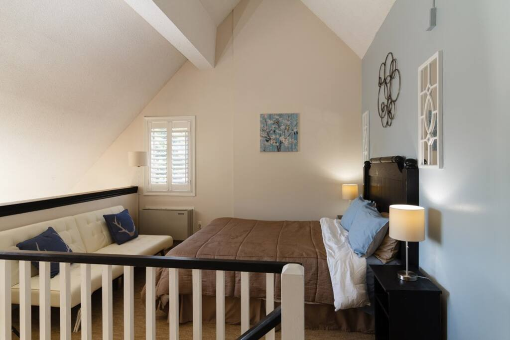 Our loft bedroom offer a full queen bed and stunning views of the slopes.