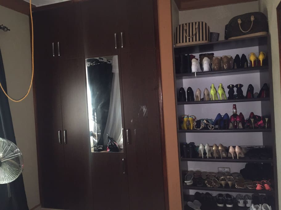 shoe rack and wardrobe in main bed room