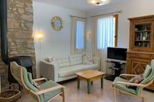 Domaine la Pique, Tournesol, living area with woodstove and sat TV