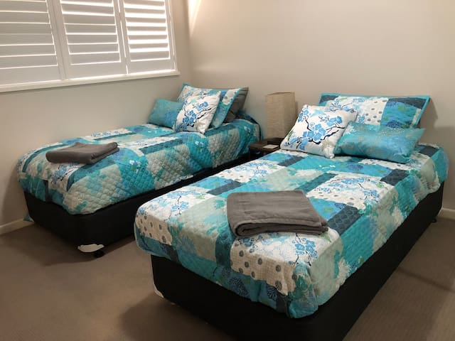 2 single beds with quality mattresses
