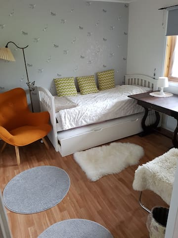 Bedroom 1, the biggest of all 3 bedrooms. The bed is a pull out bed which can also be raised to a doubble bed. It has very comfortable madresses of good quality (Jensen). The room has dimming curtains to prevent the midnight sun to disturb you.
