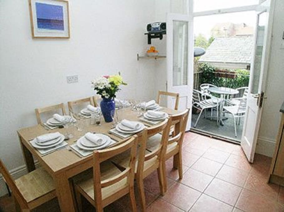 This large kitchen Diner also leads out onto a sunny balcony and then a courtyard garden.