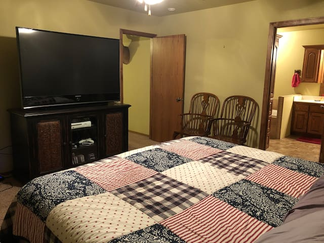 Master Bedroom with King-bed, TV and Master Bath separated from main living area.