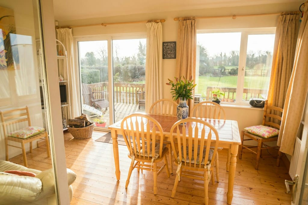 Bright airy sunroom/dining room opens out southfacing deck and gardens.