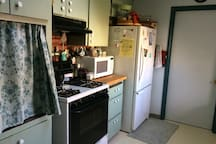Kitchen available for cooking and dining.