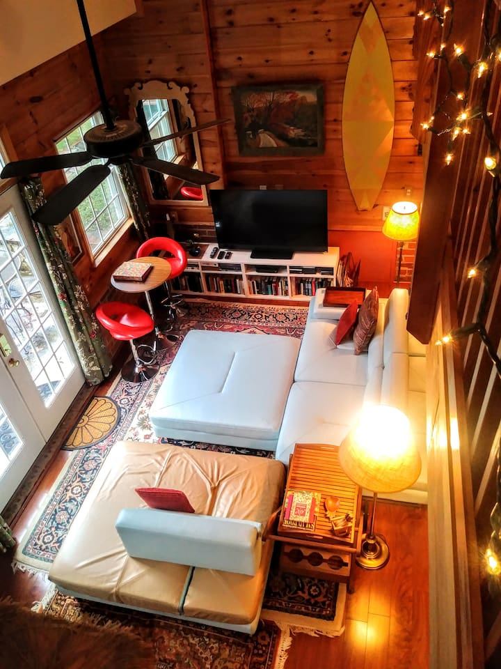 View of the living area from the upper loft