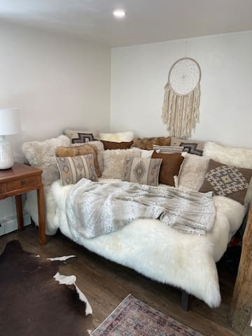 Plush daybed perfect for reading and napping, or can be made up as a 2nd bed for extra guests (It's a queen mattress)