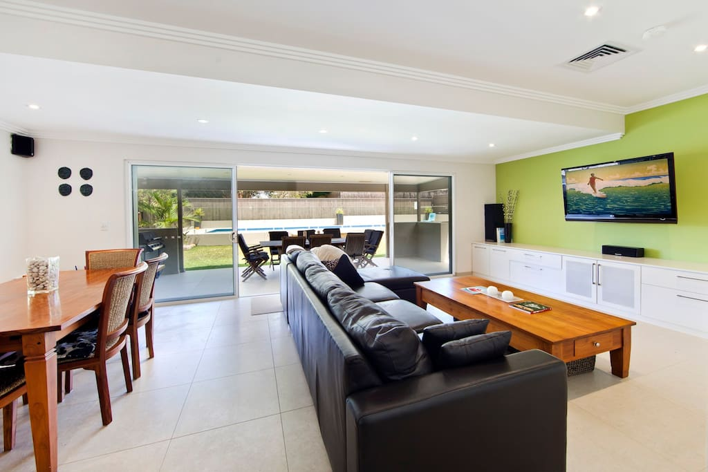 Spacious living and dining leads to resort style outdoor area with pool.