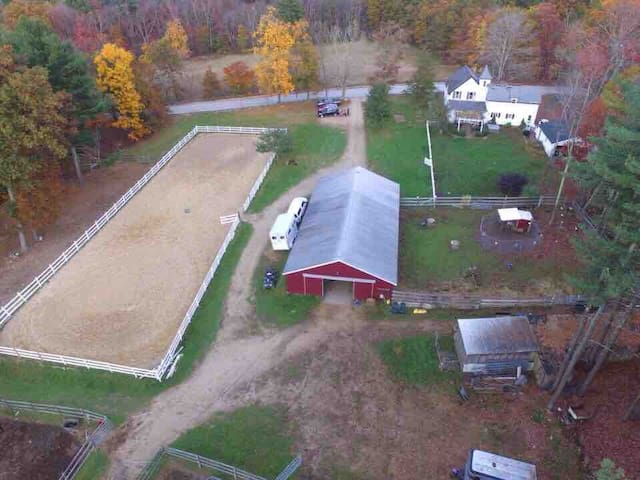Drive photo of the farm. Full sized large dressage arena. Trails from property