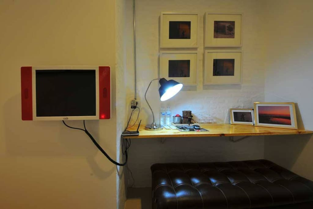 Working desk and smart TV with internet, movies and local channels