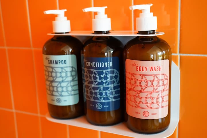Every shower comes stocked with soap, shampoo, and conditioner.