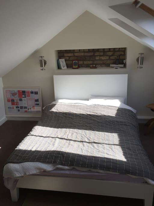 Attic Bedroom with en suite toilet and shower. Double bed with memory foam mattress topper. Bright, quiet and warm. Veluxes have blackout blinds.