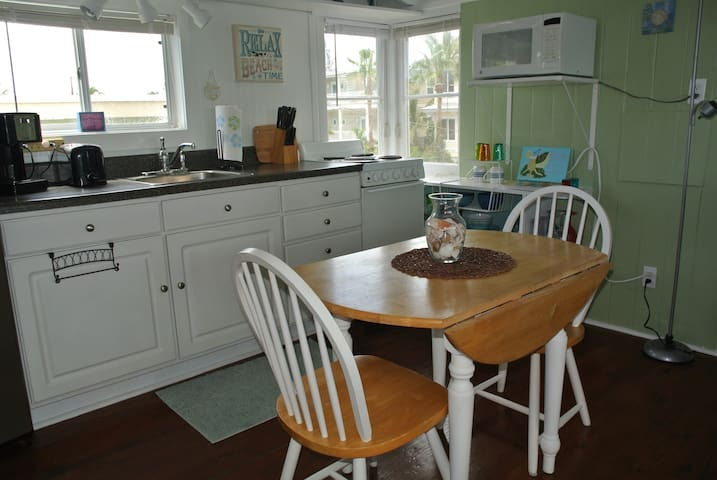 Kitchenette & seating for two with peeks of the gulf out the window.
