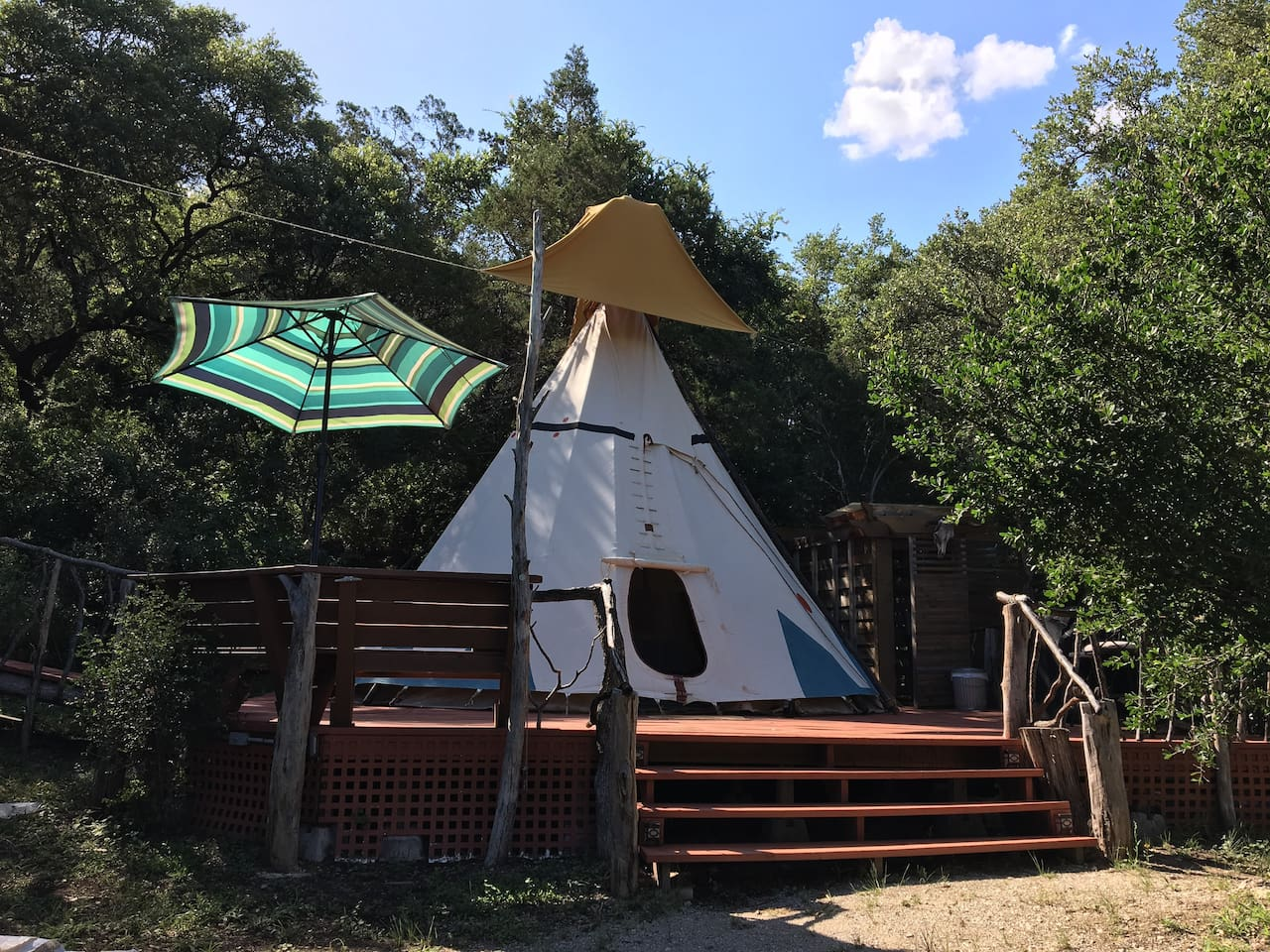 The Tee Pee is built on a spacious deck with a bench, grill, table & semi-outdoor bathroom.   It has a rain cap on top to keep it dry during sudden rains