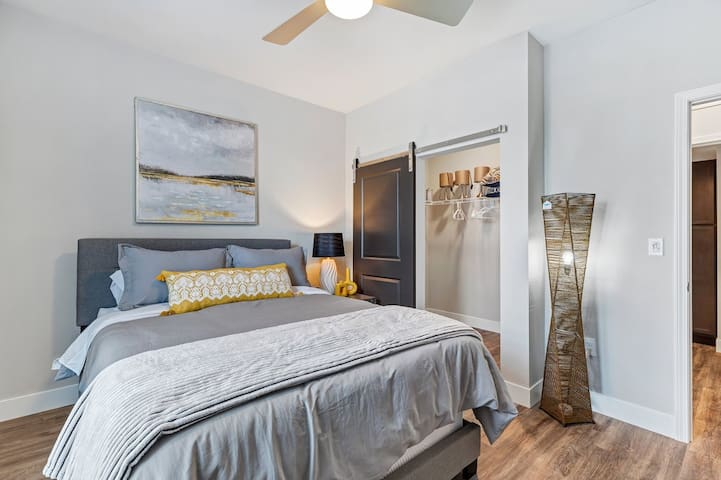 Master Suite #2. Spacious walk in closet, smart TV, ceiling fan, very comfortable queen bed set, full bath across the hall.