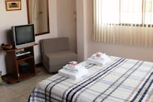 Bedroom 1: 1 Queen bed and 1 single sofa bed. Sleeps 3