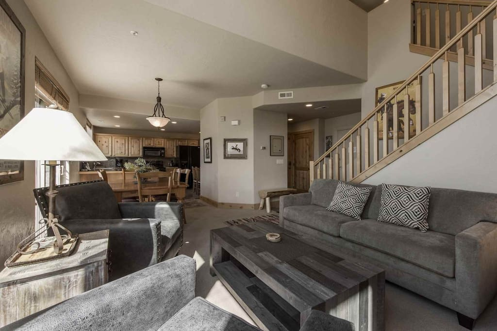 The living room invites guests to relax in soft suede furnishings, while watching your favorite sport's team on a large HDTV by the fireplace.