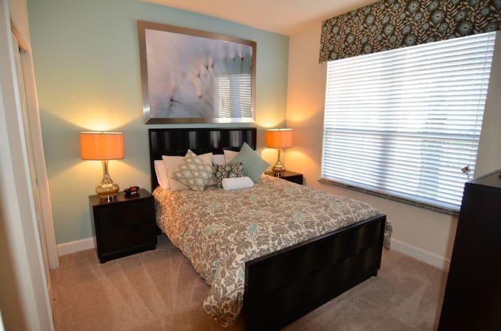 Bedroom 2 is an attractive queen room with en suite bathroom and flat screen TV