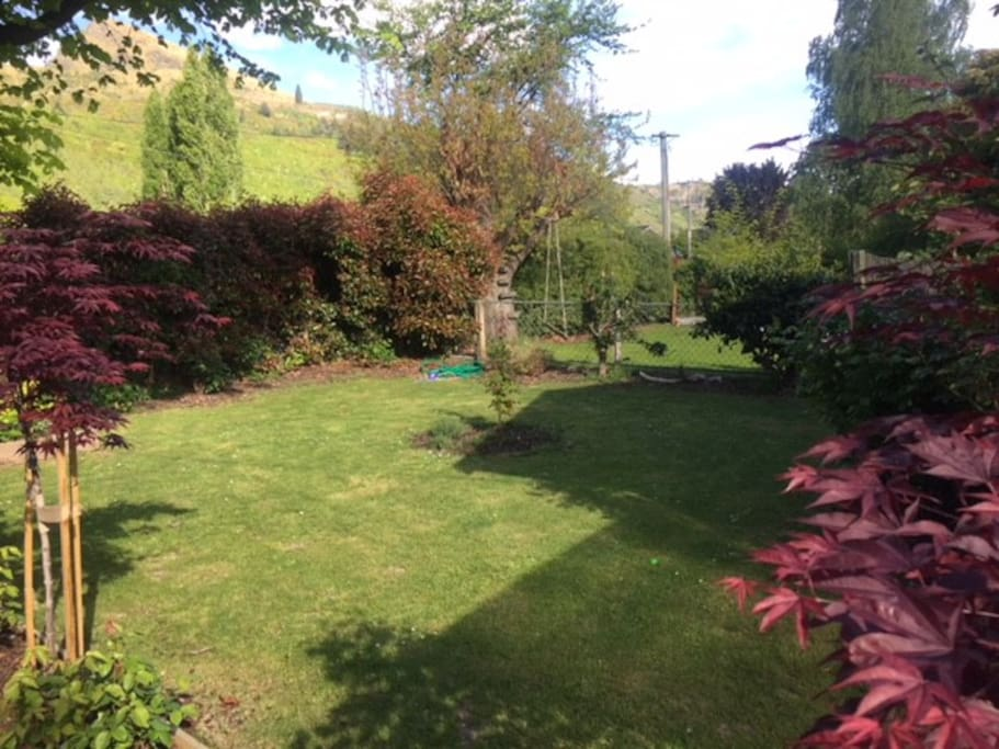 Front Garden. Which we don't mind if you need to pitch a tent to sleep more guests. Also has an awesome kids swing.