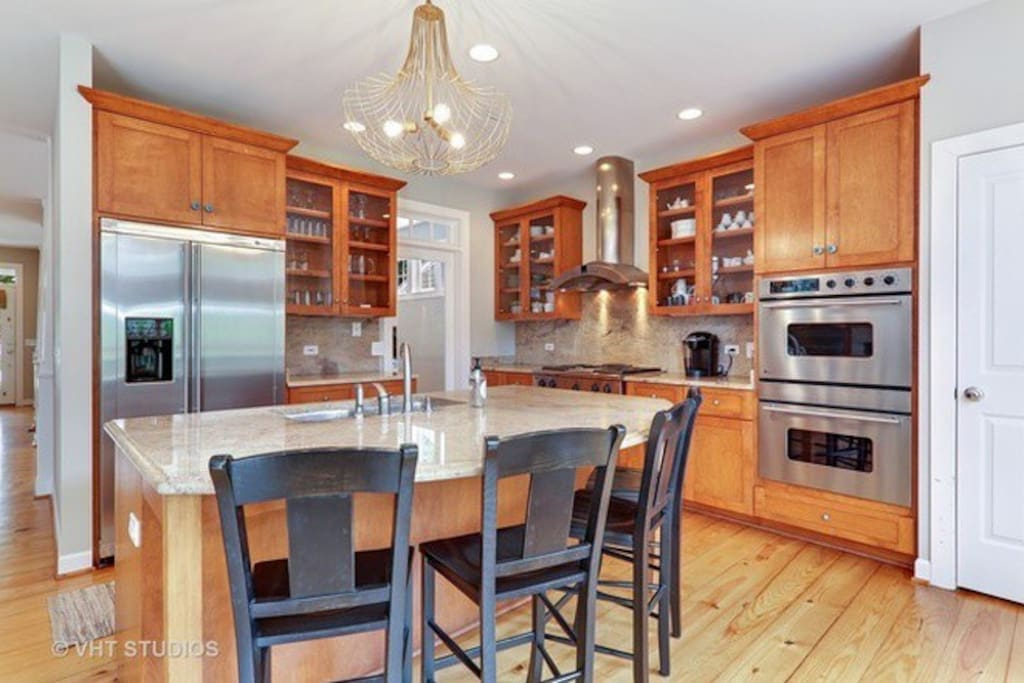 Kitchen island. Laundry facilities available for us in basement