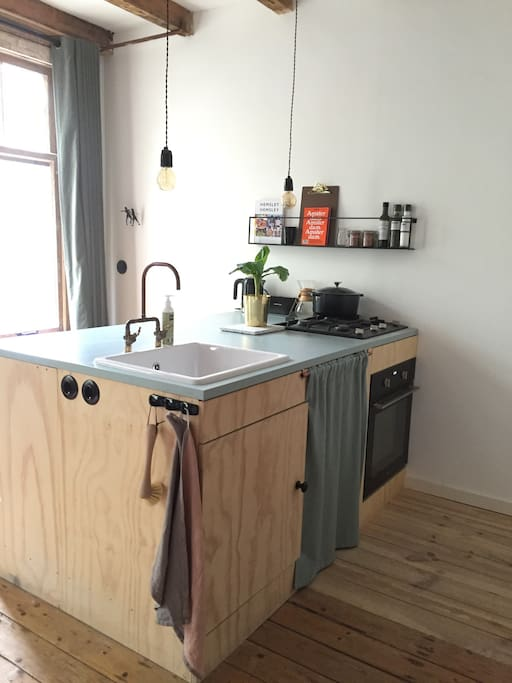 Kitchen island with oven and refrigerator