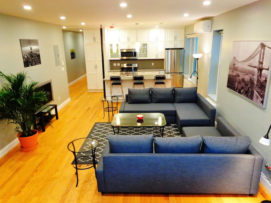 APT #1: Living area sofa converts to beds (accommodates 4 guests)