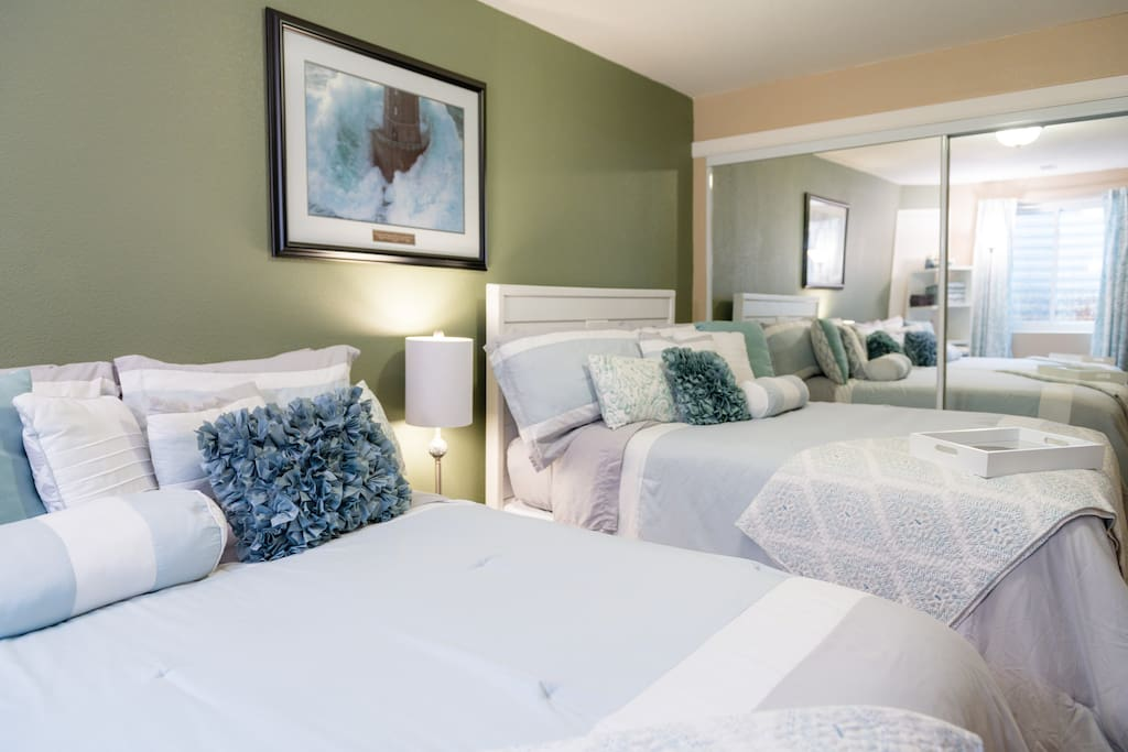 There are two full size beds in a bedroom that closes off with French doors for additional privacy. This area comfortably sleeps 4 guests.