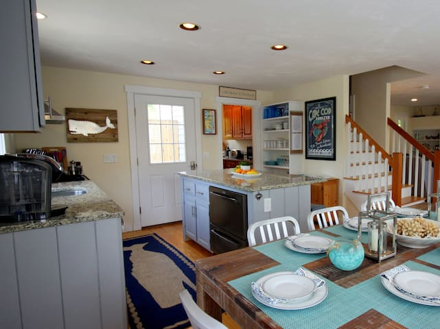 Stainless appliances & granite.  Well stocked for cooking and entertaining.