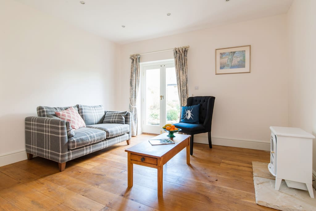 Our spacious sitting room provides plenty of space to relax and enjoy your stay. There is an electric fire as well in case you need to get super cosy.
