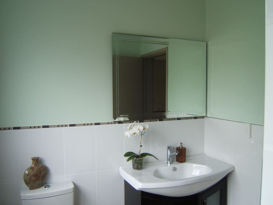 Clean fresh bathroom with shower and toilet
