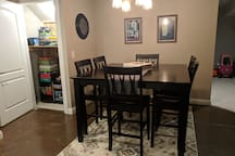 Pub height dining table and a closet full of family games!