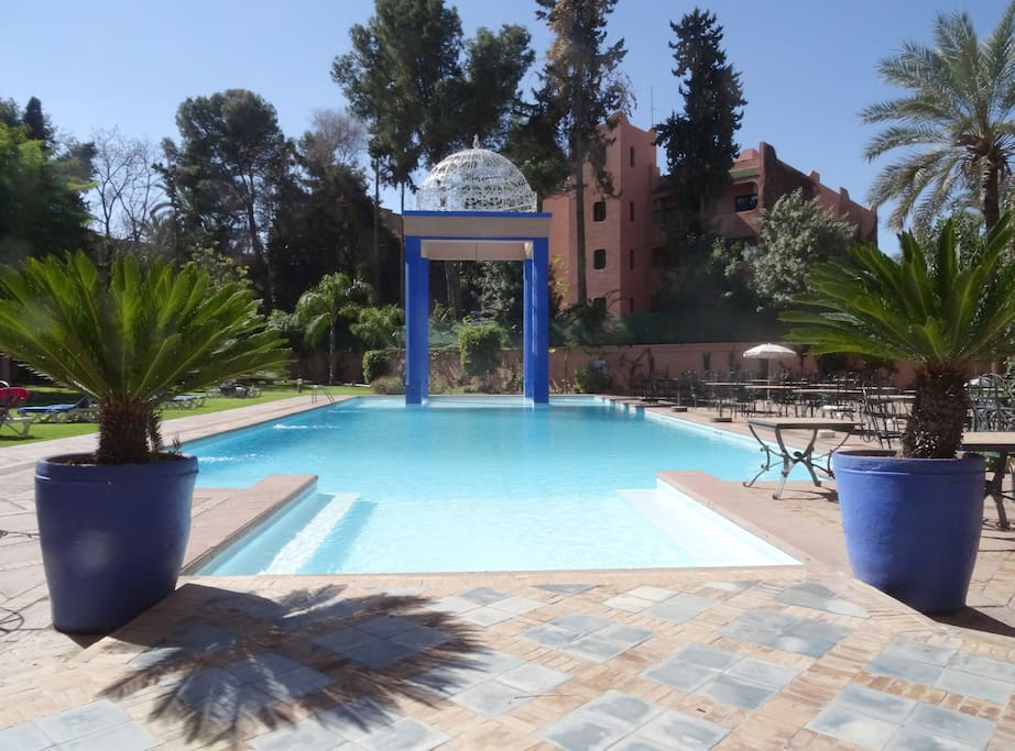 Rare in city center, free access to a large, private, sparkling - members only -  pool,located nearby the apartment and shaded by flowering bougainvillea, palms, and orange trees.