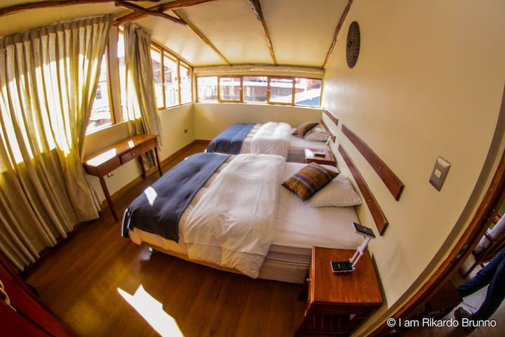 The second bedroom has two double beds and a huge window that overlooks the Historical Centre and Cusco's mountains