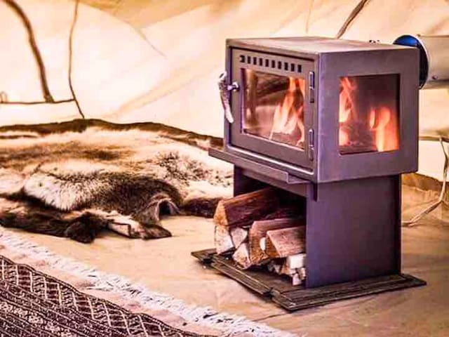 For those chilly nights, the tent is equipped with a wood stove for our guests to enjoy.  Simply use a lighter to light a couple pieces of kindling in between two logs and leave the door cracked until the fire builds up.