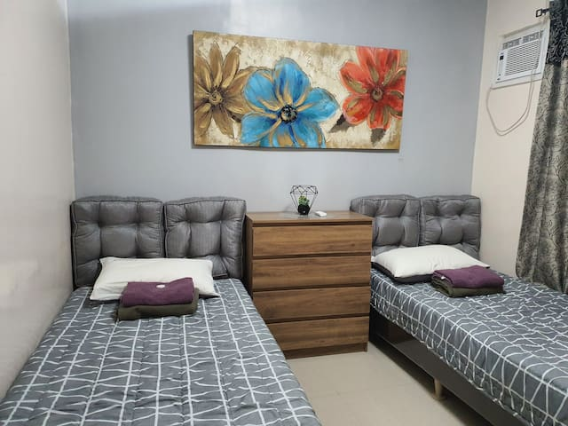 Slumber in  a comfy, relaxing and cozy beds after a tiring day. Bedroom1 is  fully air-conditioned.