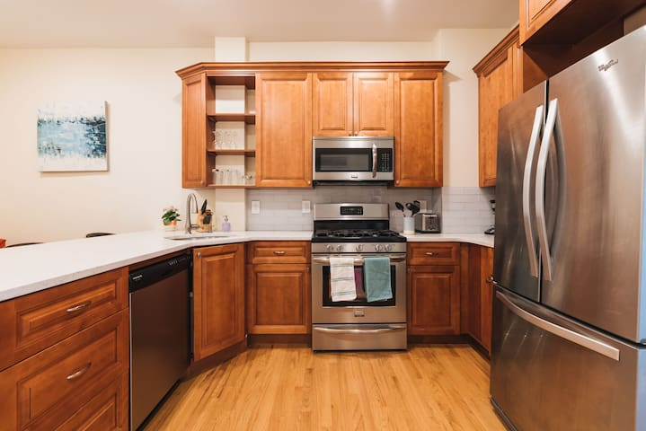 Brand new stainless steel appliances and quartz countertops.