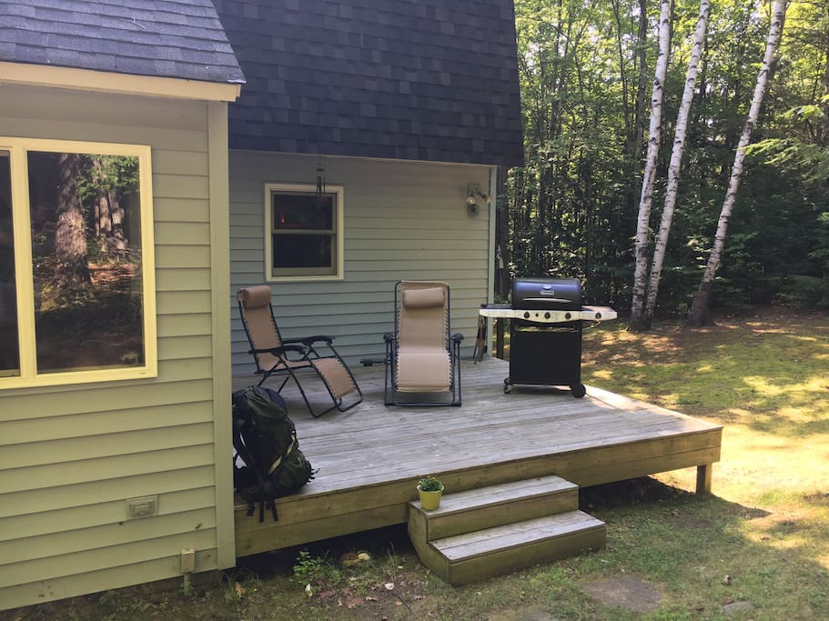 The back deck just to the south of the Adirondack Room. We provide propane for this large propane grill – plus an extra tank in an exterior storage shed for the inevitable situation where you get halfway through grilling a big meal and run out of gas!
