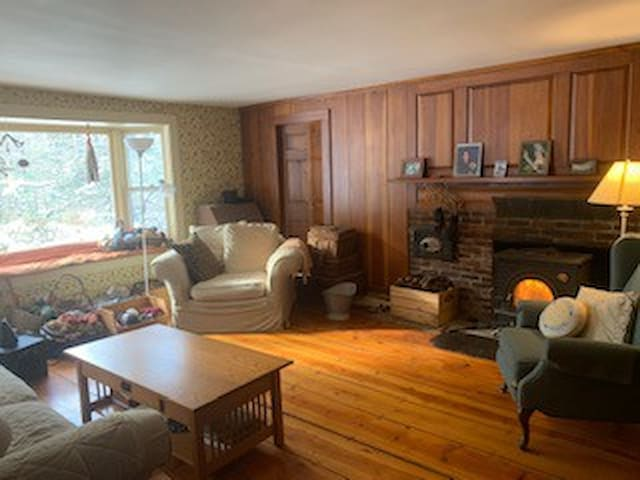 shared living room with woodstove