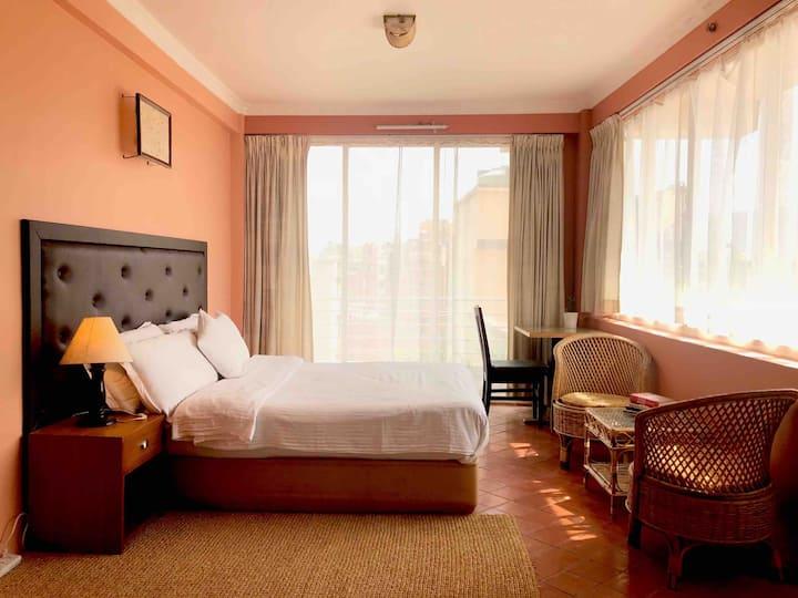 Spacious, bright room on terrace floor in Patan