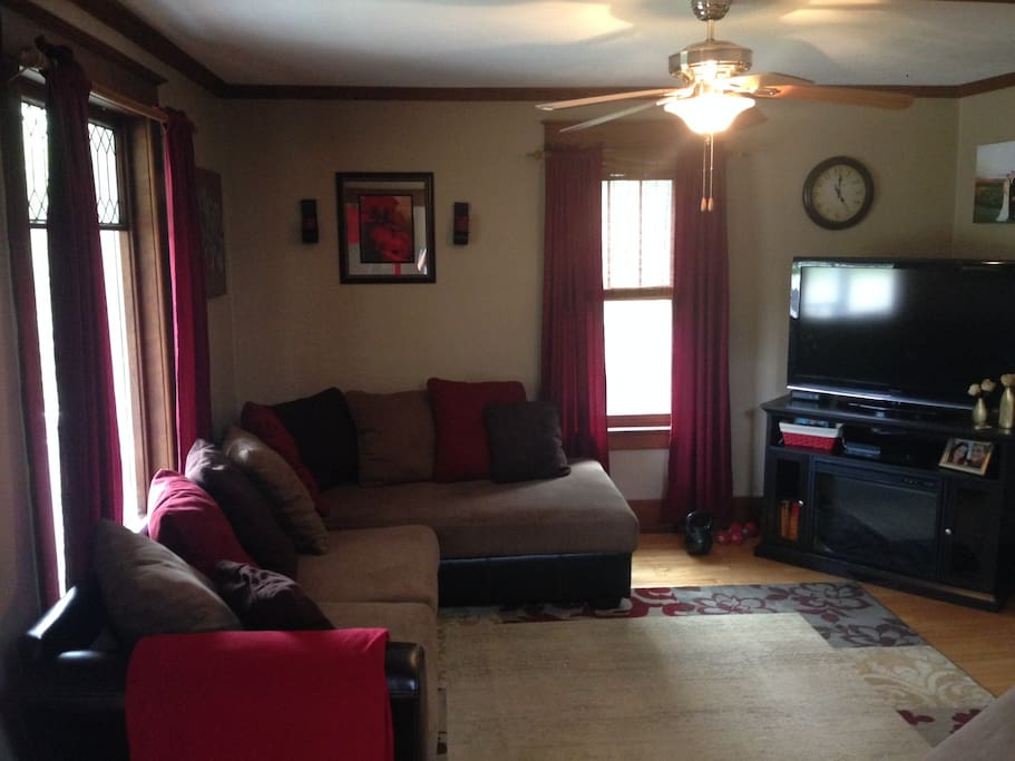Main floor living room with sectional couch, love seat and ottoman.