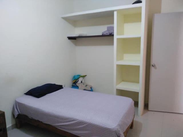 Habitacion en departamento en zona residencial