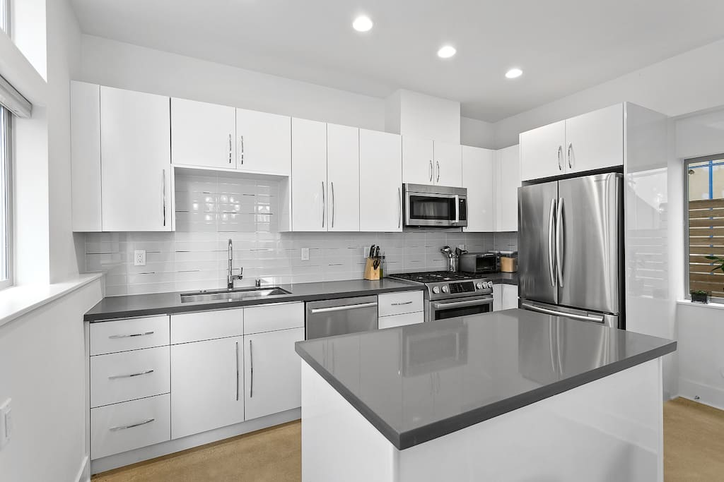 Kitchen complete with gas appliances, microwave, and toaster oven. You will have some fridge space & feel free to cook!